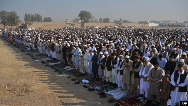 Waiting for peace: Afghan refugees at Eid al-Adha prayers in Peshawar in November
