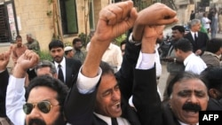 Antigovernment lawyers shout slogans during a protest before the start of a long march in Karachi on March 12.