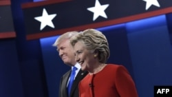 U.S. Republican presidential nominee Donald Trump (left) and Democratic presidential nominee Hillary Clinton arrive on stage for the first presidential debate at Hofstra University in Hempstead, New York, on September 26.