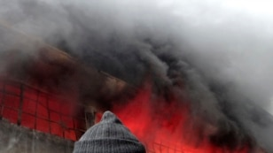 A firefighter attempts to extinguish a fire at a factory after what activists said was shelling by forces loyal to Syria's President Bashar al-Assad in Aleppo on February 8.