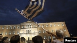 Protests flared November 7 outside the Greek parliament in Athens.