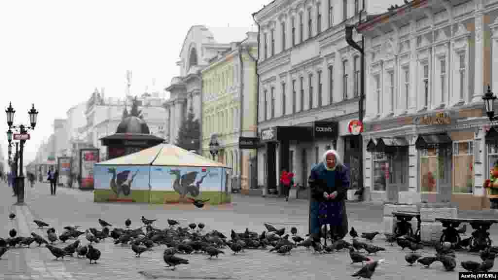 A woman feeds pigeons in Kazan, the capital of the Russian republic of Tatarstan.