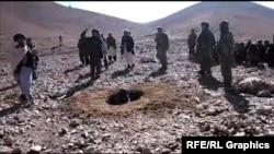 A video shows men stoning a woman in a hole to death in Afghanistan's Ghor province on October 25.