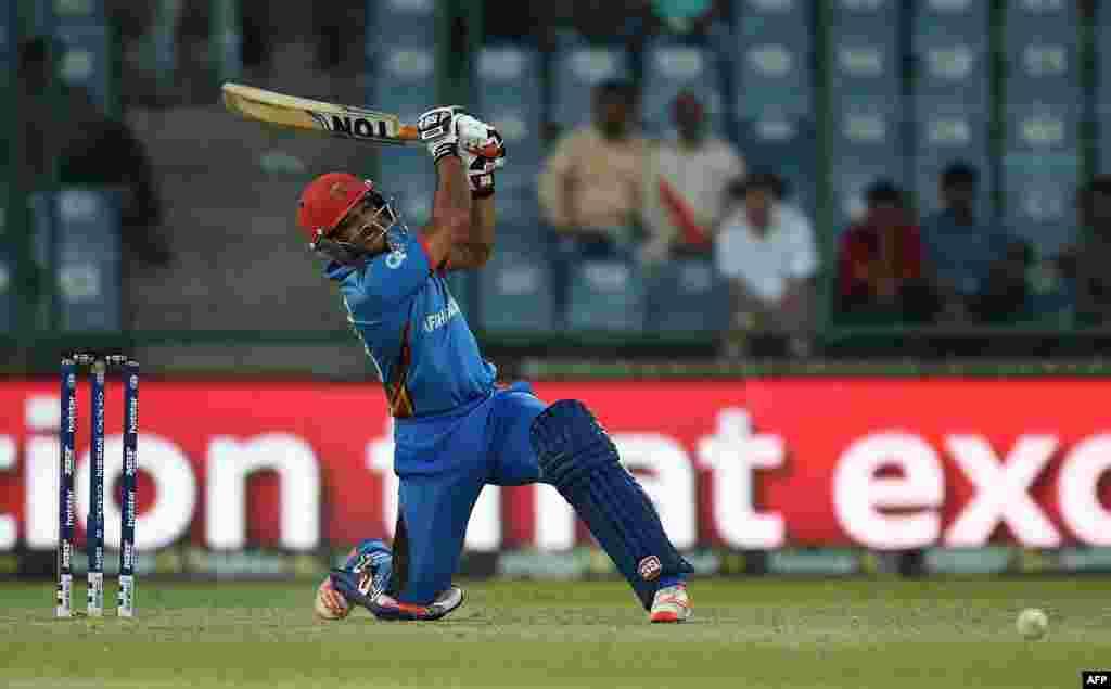 Afghanistan's Shafiqullah Shafaq bats against England at the Feroz Shah Kolta Cricket Stadium in New Delhi on March 23.