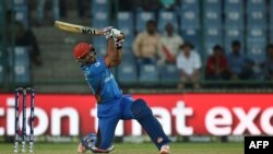 Shafiqullah Shafaq plays a shot during the World T20 cricket tournament match between England and Afghanistan at Feroz Shah Kolta Cricket Stadium in New Delhi in March 2016.