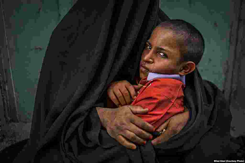 This photo of a beggar with her child was published by the Fars news agency, but it was quickly taken down, Alaei said. His editors said that the sanctity of the chador had been violated because of the obvious poverty in the photo.