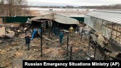 Emergency personnel work at the site of the fire in the village of Nesterovo outside Moscow on January 7.