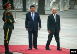 Ashraf Ghani (right) inspects a guard of honor with Chinese President Xi Jinping during the Afghan leader's trip to China shortly after he became president in 2014.