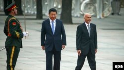 File photo of Afghanistan's President Ashraf Ghani (R) and Chinese President Xi Jinping.