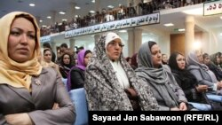 Delegates listen to Afghan President Hamid Karzai speak during the first day of the Loya Jirga on November 16.