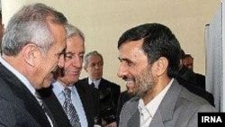 Iranian President Mahmud Ahmadinejad (right) with his Lebanese counterpart, Michel Suleiman, in Tehran on November 24.