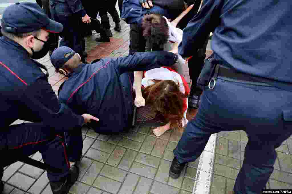 A student is detained by police.