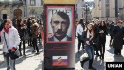 «Столп позора» с изображением Владимира Путина. Львов, 11 марта 2014 года