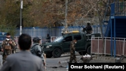 AFGHANISTAN -- Afghan security forces inspect the site of a blast in Kabul, November 12, 2018