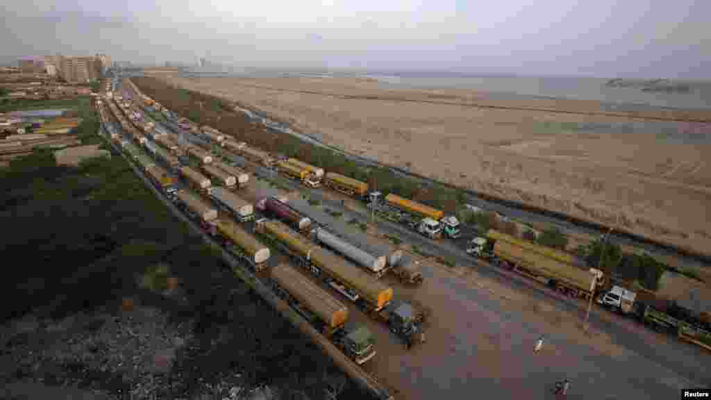 Fuel tankers are parked at a compound in Karachi on May 16.