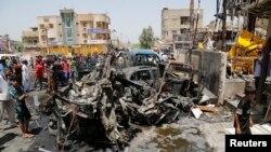 صورة من الأرشيف لسيارة مفخخة في مدينة الصدر - بغداد 1 آب 2014
