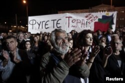 Сторонники СИРИЗы во время одного из маршей протеста в Греции