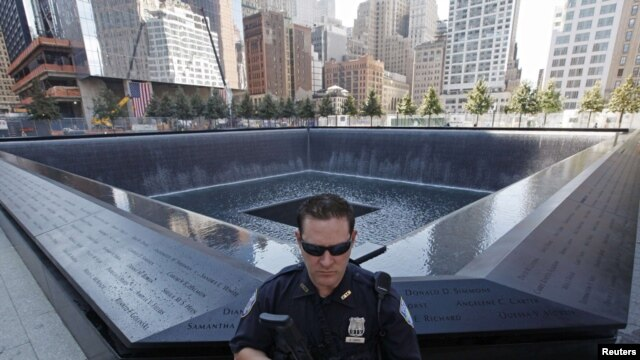 U.S. Port Authority officer provides security at the South Pool at the World Trade Center construction site in New York on September 9.
