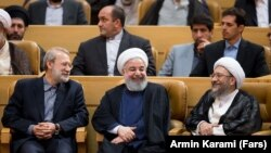 Iran -- Iranian Parliament speaker Ali Larijani (L), Iranian President Hassan Rouhani(C) and Sadeq Larijani Head of Iran's Judiciary. File photo