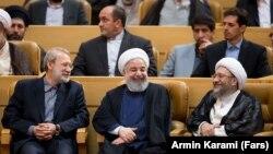 Iran -- Iranian Parliament speaker Ali Larijani (L), Iranian President Hassan Rouhani(C) and Sadeq Larijani Head of Iran's Judiciary. File photo