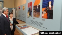 Armenia - President Serzh Sarkisian looks at a stand in the National Hisotry Museum in Yerevan displaying his and his predecessors' pictures, 13Sep2011.