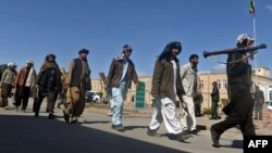 Taliban fighters walked with their weapons as they joined government forces during a ceremony in Herat province in March.