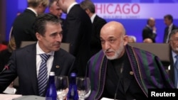 NATO Secretary-General Anders Fogh Rasmussen (left) and Afghan President Hamid Karzai