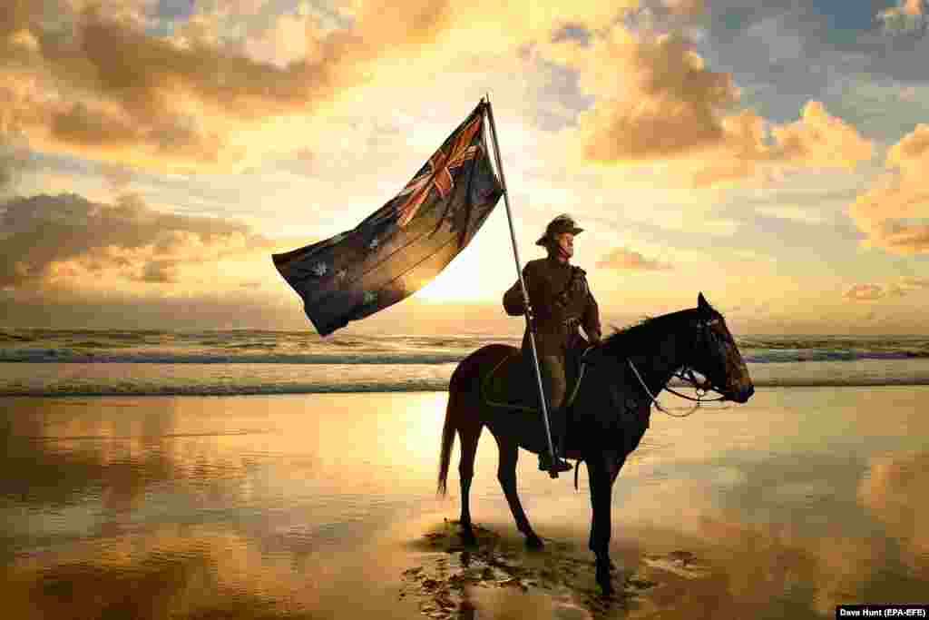 Chris Kennedy and his horse Chaos pose for photos on Currumbin Beach ahead of Australian and New Zealand Army Corps (ANZAC) Day on the Gold Coast of Australia on April 24. Anzac Day, held annually on April 25, commemorates the people who lost their lives or served in wars and conflicts. (epa-EFE/Dave Hunt)