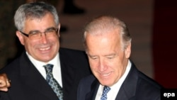 U.S. Vice President Joe Biden (right) is welcomed to Sarajevo by Bosnian Foreign Minister Sven Alkalaj.