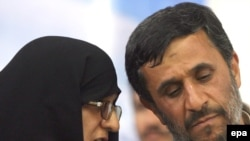 Ahmadinejad with his wife at an election campaign rally in Tehran on June 2