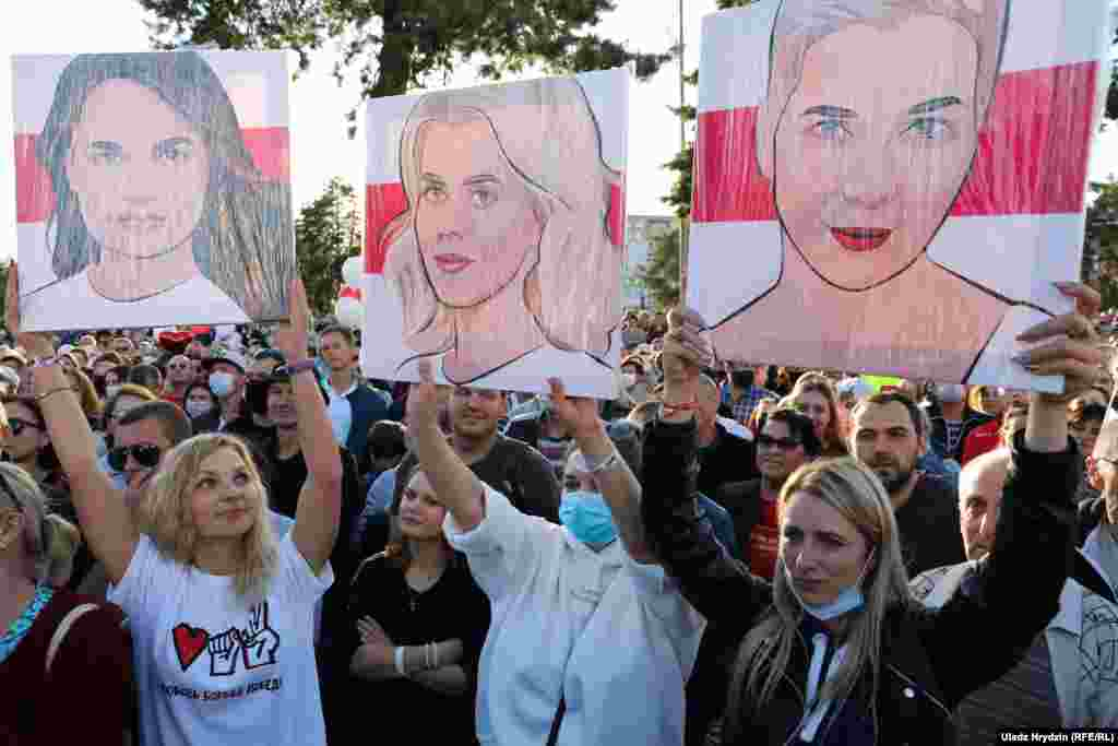 Supporters hold posters of the female trio who together are challenging Lukashenka's rule: (left to right) Svyatlana Tsikhanouskaya, Veranika Tsapkala, and Maryya Kalesnikava. ​Tsikhanouskaya joined forces with Tsapkala and Kalesnikava, who both represented would-be presidential candidates who were barred from the August 9 ballot.