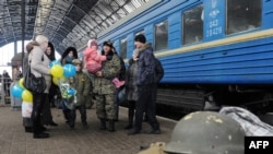 A file photo shows Ukrainian servicemen with relatives on a railway platform at a station in the western Ukrainian city of Lviv in January.
