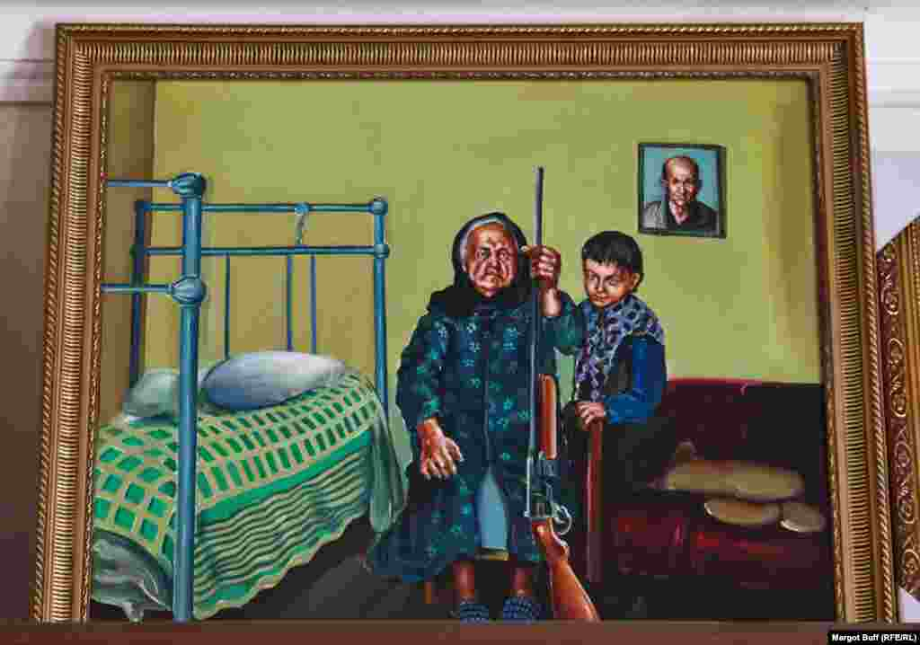 A painting in a souvenir shop in Stepanakert shows a grandmother holding a gun.
