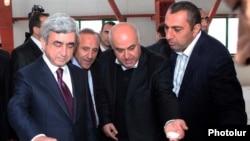 Armenia - President Serzh Sarkisian (L) visits a new sugar refinery built by businessman Samvel Aleksanian (R).