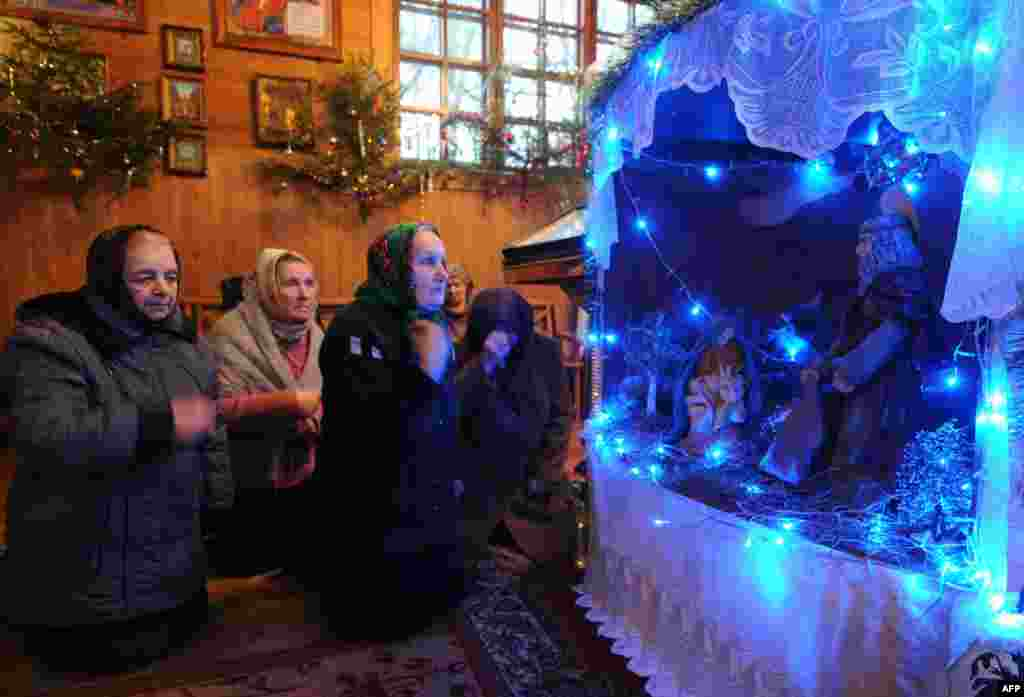 In Belarus, people pray in a church in the village of Plisa on January 6, 2014.