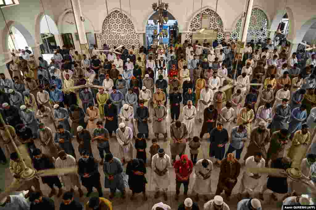 No physical distancing and very few masks as devotees gather at this mosque in the Pakistani capital, Islamabad, on May 22. They are among some 1.8 billion Muslims who celebrate Eid al-Fitr around the world.