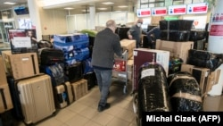 Russian Embassy staff arrive with their possessions at Vaclav Havel Airport in Prague following the expulsion of Russian diplomats from the Czech Republic in April.