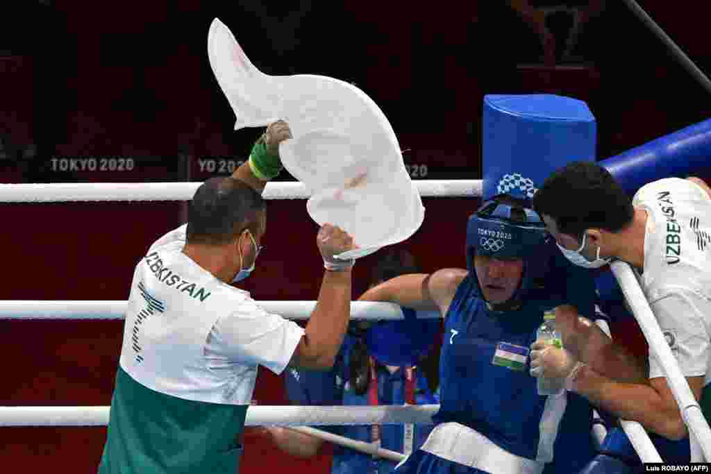 Uzbekistan's Shakhnoza Yunusova takes a break as she fights Poland's Karolina Koszewska during the women's welter (64-69kg) preliminaries boxing match during the Tokyo 2020 Olympic Games at the Kokugikan Arena in Tokyo on July 24, 2021.