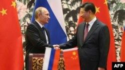 Presidenti rus, Vladimir Putin dhe homologu i tij kinez, Xi Jinping - Arkiv