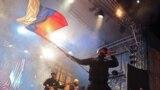 Президент Росії Володимир Путін на сцені в Сімферополі на святкуванні п'ятої річниці анексії Криму
