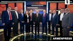 Armenia - The leaders of 11 parties and blocs running in parlamentary elections pose for a photograph before a live debate hosted by Armenian Public Television, December 5, 2018.