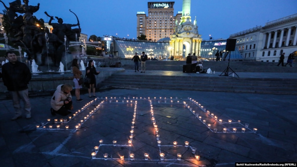 People lay candles in Kyiv to commemorate the deportation of the Crimean Tatars on May 18.