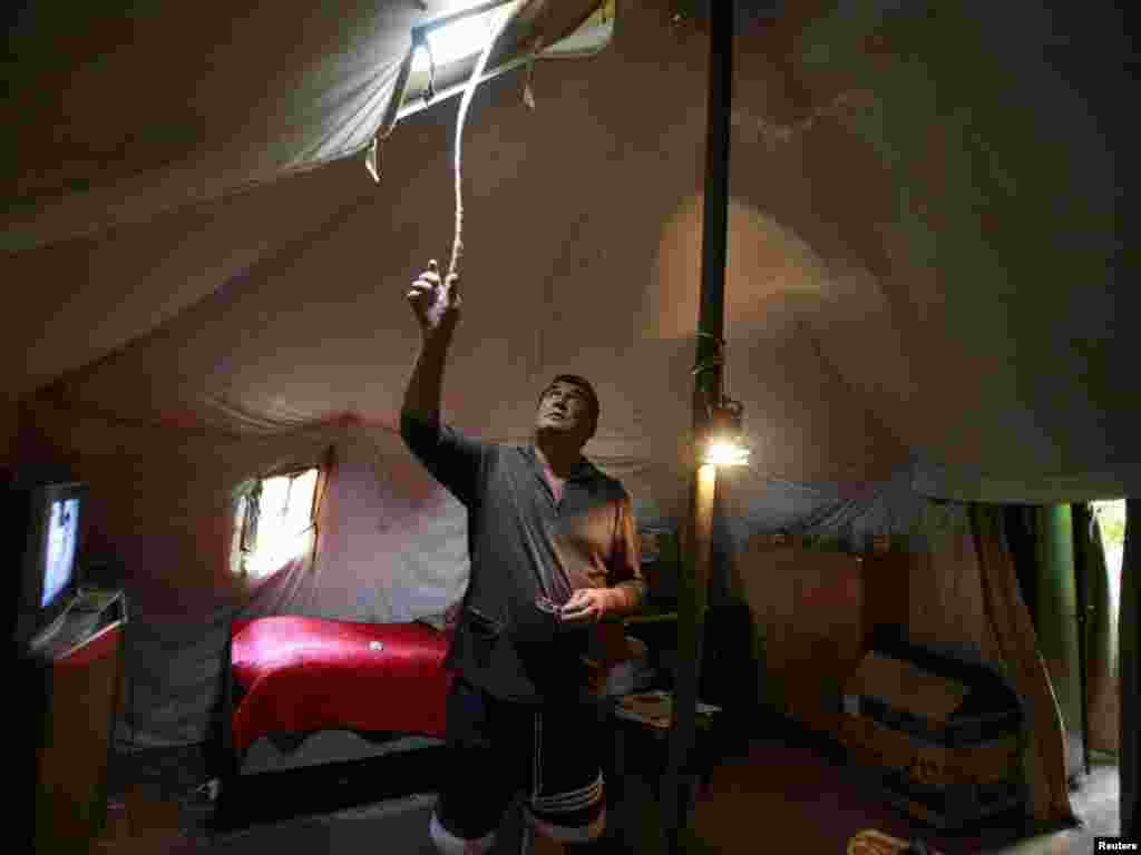 Grigory Dzasokhov stands in a tent, where he lives with his wife, as his house was destroyed during Georgia's war with Russia over South Ossetia, in Tskhinvali, July 22. Photo by Kazbek Basayev for Reuters