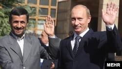 Iranian President Mahmud Ahmadinejad (left) with his Russian counterpart, Vladimir Putin (file photo)