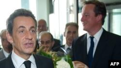 Франция Президенти Н.Саркози (ч) ва Британия Бош вазири Д.Камерон, Триполи, 2011 йил 15 сентябр