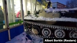 The driver of this armored personnel carrier smashed through a storefront and stole a bottle of wine.