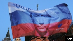 A Russian flag features the likeness of President Vladimir Putin in Moscow.