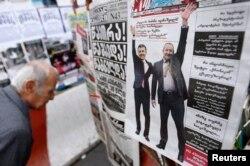 Un ziar cu imaginea lui Bidzina Ivanishvili (stânga) și președintele Giorgi Margvelashvili