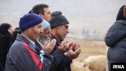 Residents of Qaen pray together for rain in the deserts around the Iranian city.