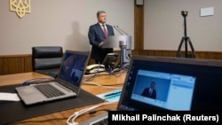 The deputy head of his administration was worried Ukrainian President Petro Poroshenko's video testimony in former President Viktor Yanukovych's treason trial would be hacked.